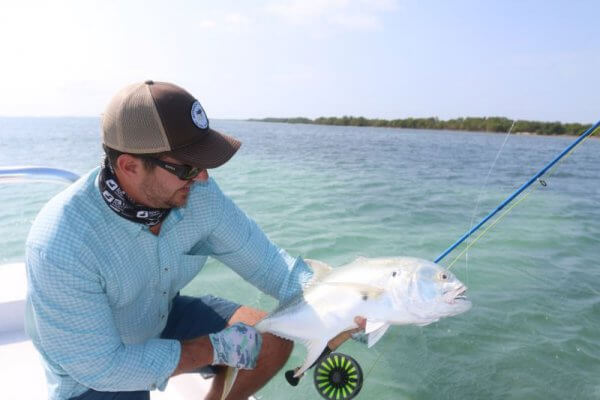 man showing fish size