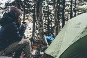 woman camping with coffee