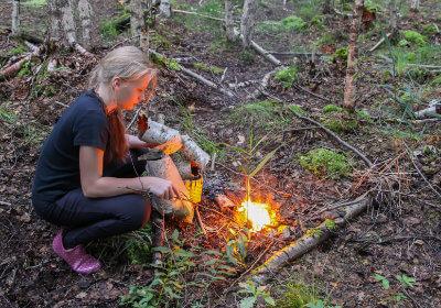 teen-making-fire