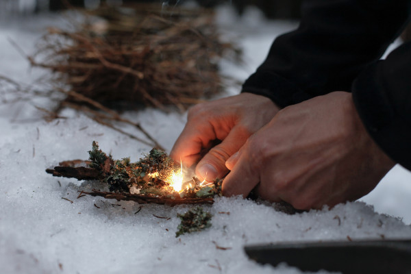 starting fire in the snow